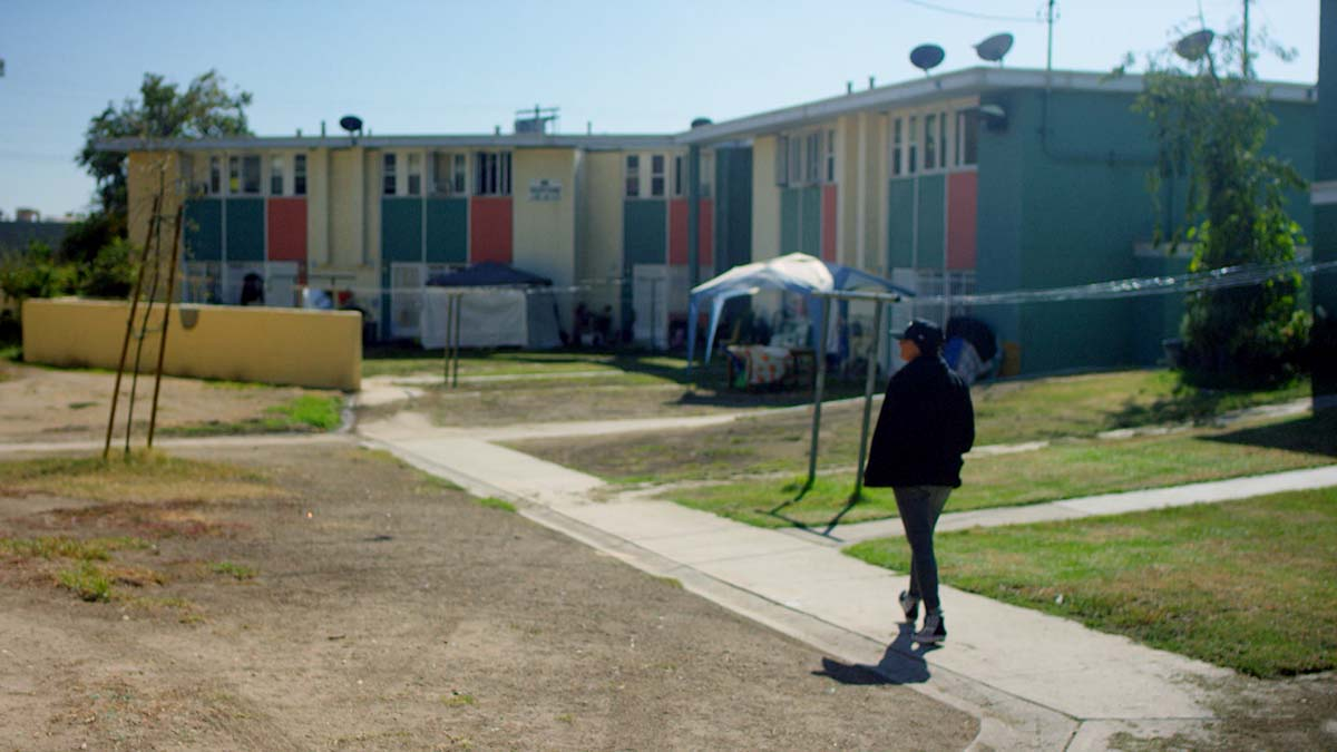 "Mar Diego visits San Fernando Gardens, otherwise known as Pacoima projects | Still from ""Broken Bread"""