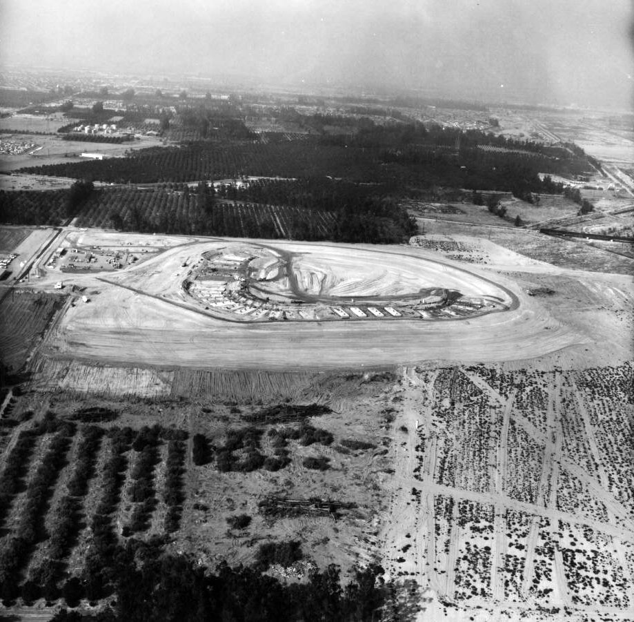 Anaheim Stadium and the surrounding parking rose from formerly agricultural land once devoted to growing corn, alfalfa, and oranges. Here, bulldozers clear the site for construction.