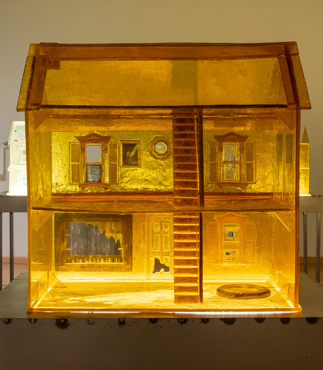 "Installation view of ""Sula Bermúdez-Silverman: Neither Fish, Flesh, nor Fowl"" at CAAM featuring a yellow dollhouse made of sugar. 