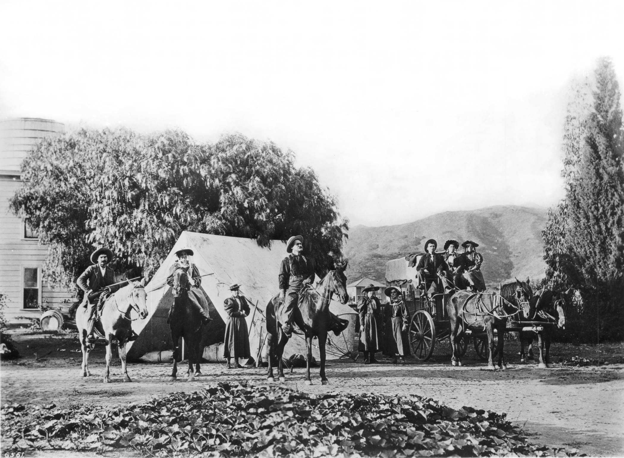 Group of campers on Franklin Avenue near Bronson Street, Hollywood, California, ca.1905