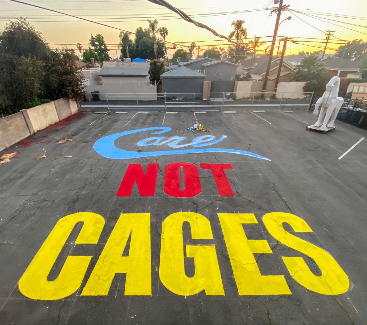 """Care Not Cages"" mural created outside of the Crenshaw Dairy Mart space 
