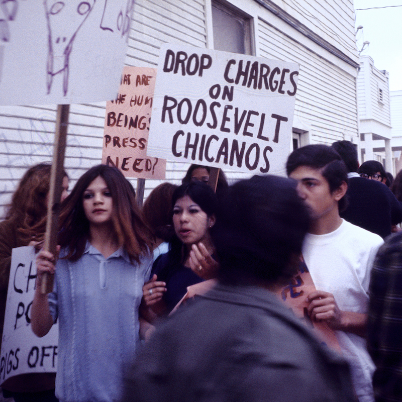"Oscar Castillo, ""Drop Charges on Roosevelt Chicanos (Roosevelt High School Walkouts),"" 1970, black and white photograph. 