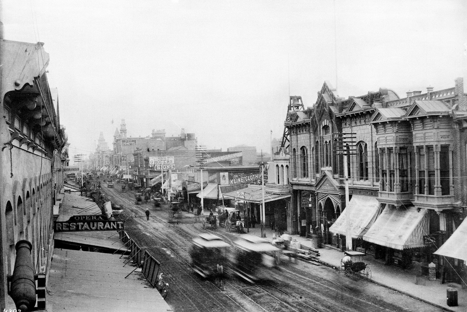 Two horsecars pass each other in a blur on Main Street between First and Second streets, circa 1889.
