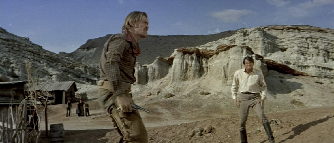 "Chuck Connors and Gregory Peck duel it out in California's Red Rock Canyon in ""The Big Country"" (1958). Jerome Moross composed the film's bombastic musical score. United Artists."