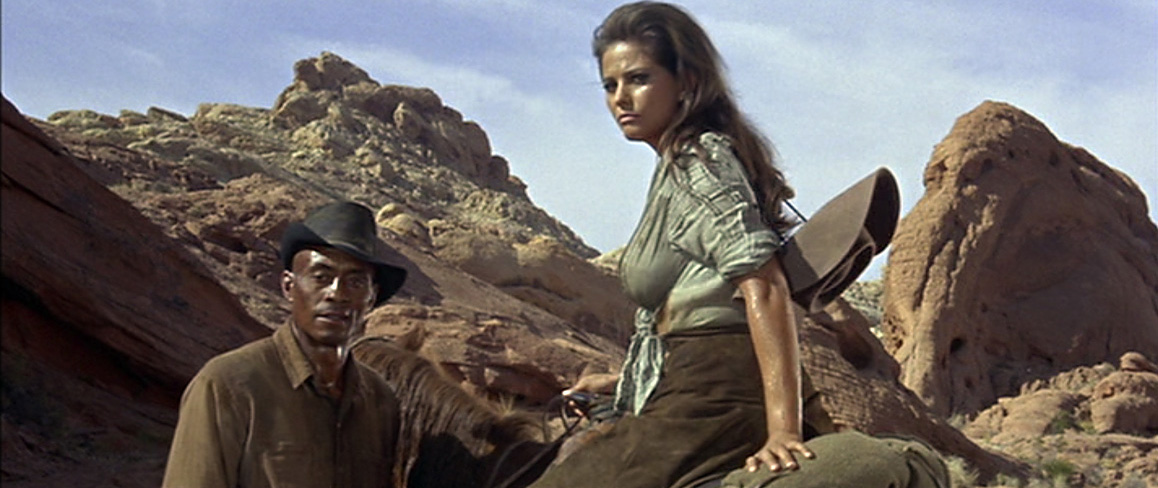 "Claudia Cardinale and Woody Strode are pictured against Nevada's Valley of Fire in Richard Brooks' 1966 film, ""The Professionals,"" that also starred Lee Marvin, Burt Lancaster, Robert Ryan and Jack Palance. Columbia Pictures."