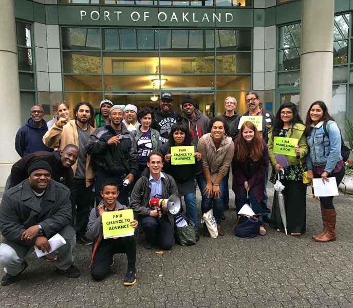 A group of EBASE and other community organizers at the Port of Oakland. | Courtesy of EBASE|