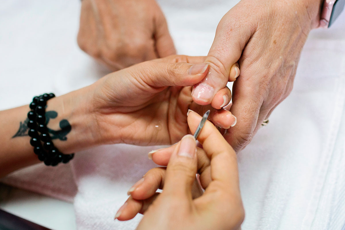 Salon worker working on a customer's manicure