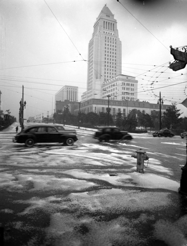 Los Angeles City Hall towers over slushy streets on Feb. 21, 1944