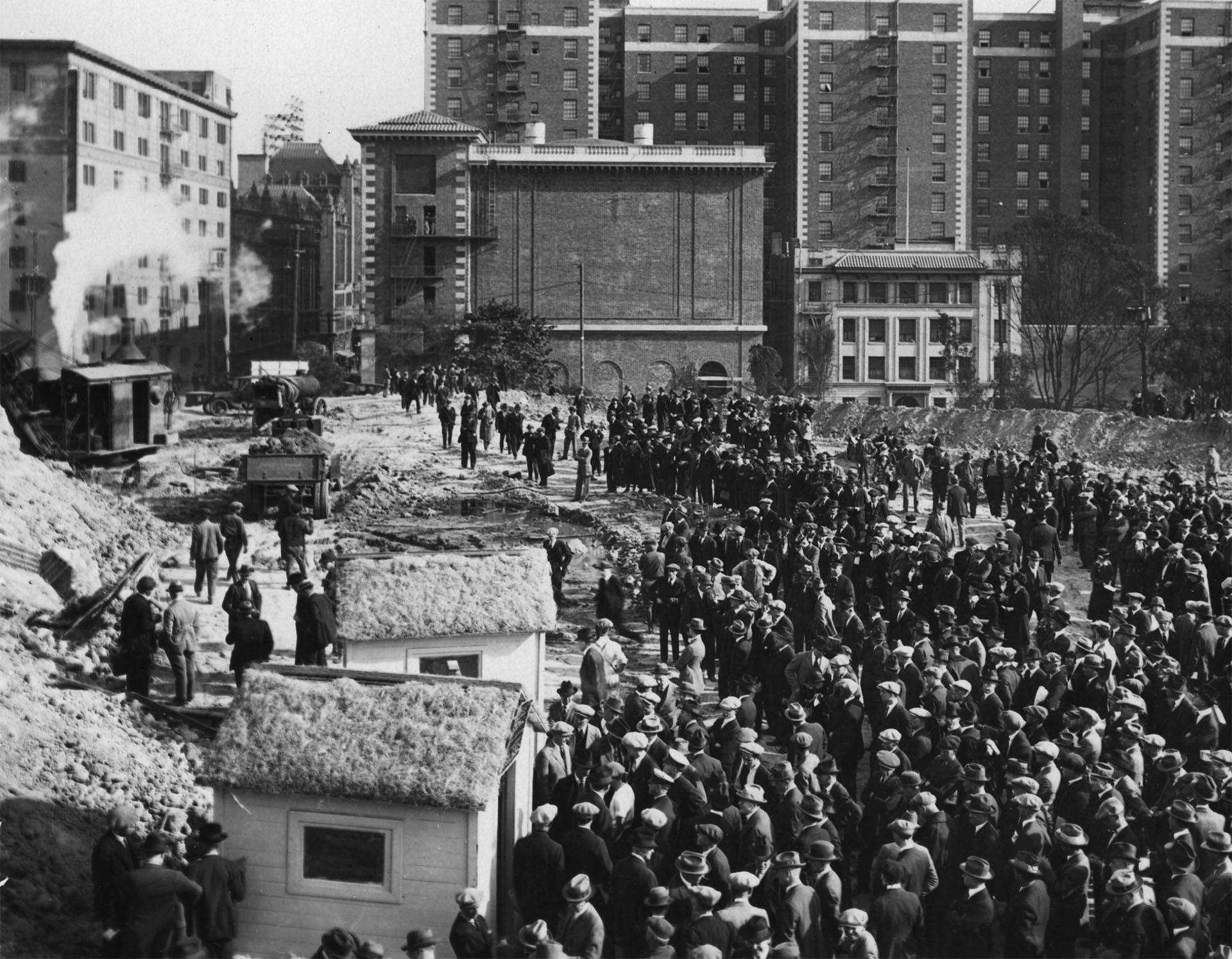 A crowd gathers at the Central Library construction site, circa 1922