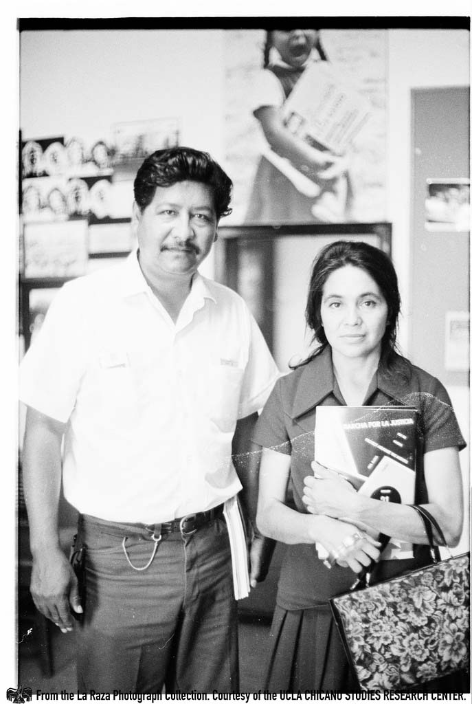 CSRC_LaRaza_B11F11C1_Staff_026 Dolores Huerta holding a copy of La Raza at the La Raza office | La Raza photograph collection. Courtesy of UCLA Chicano Studies Research Center