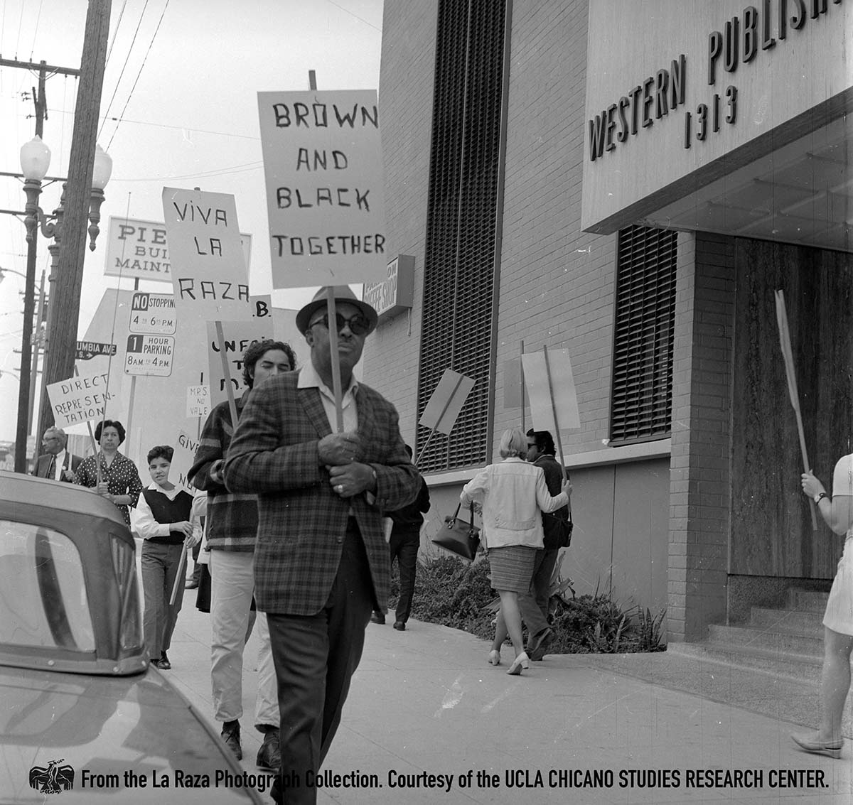 CSRC_LaRaza_B11F16S1_N002 Protest for mental helath funds outside of the Western Printing and Lithographic Company in Los Angeles | Manuel Barrera Jr., La Raza photograph collection. Courtesy of UCLA Chicano Studies Research Center