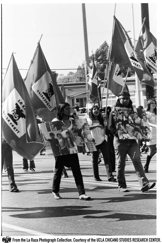 CSRC_LaRaza_B11F4C3_PB_013 La Raza Unida delegation march during the Mexican Independence Day parade in East Los Angeles | Patricia Borjon Lopez, La Raza photograph collection. Courtesy of UCLA Chicano Studies Research Center