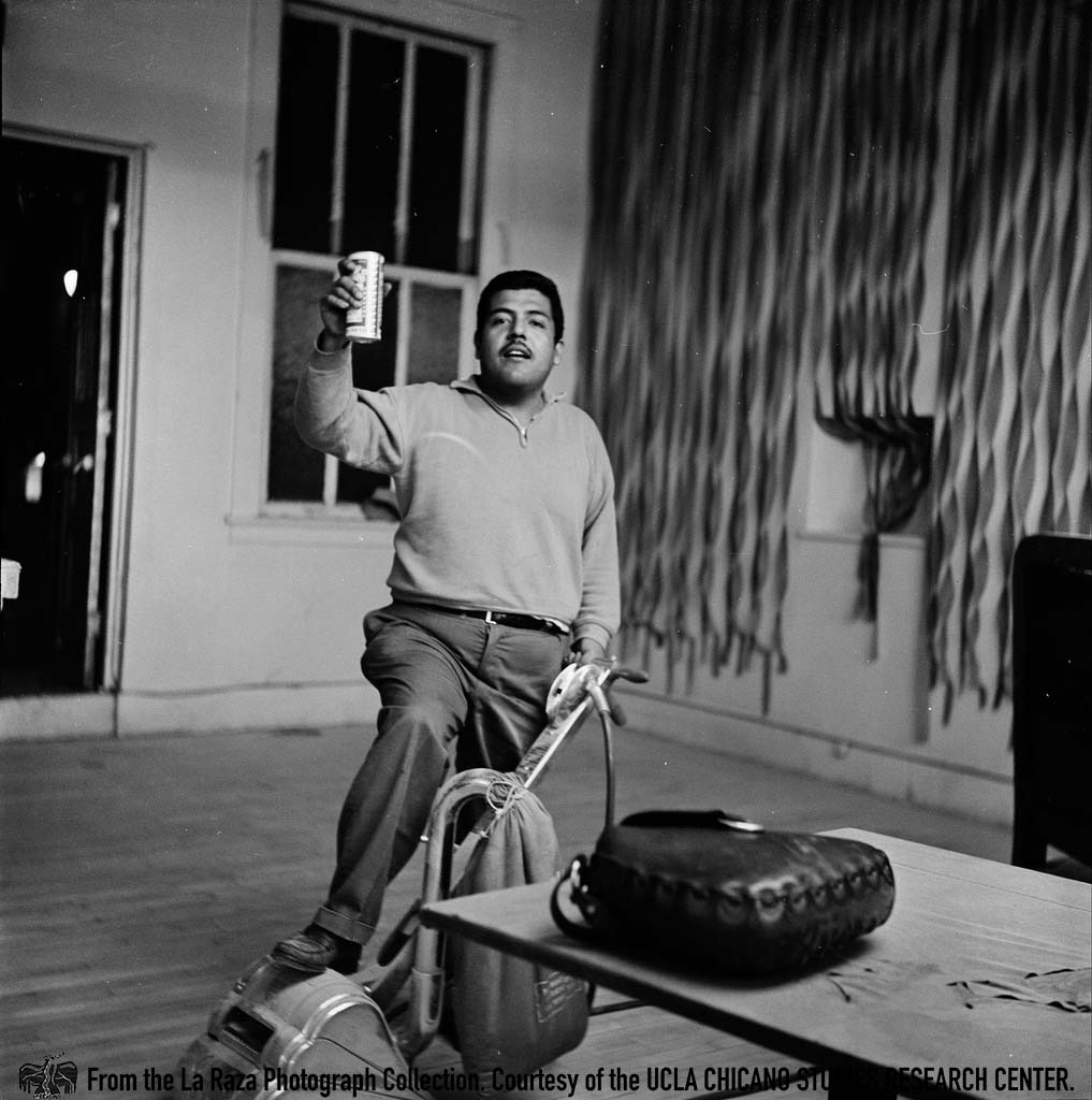 CSRC_LaRaza_B11F7C1_DW_005 Benjamin Rochin Luna, artist and staff member of La Raza, buffs the floors at the Church of the Epiphany | Deva Weber, La Raza photograph collection. Courtesy of UCLA Chicano Studies Research Center