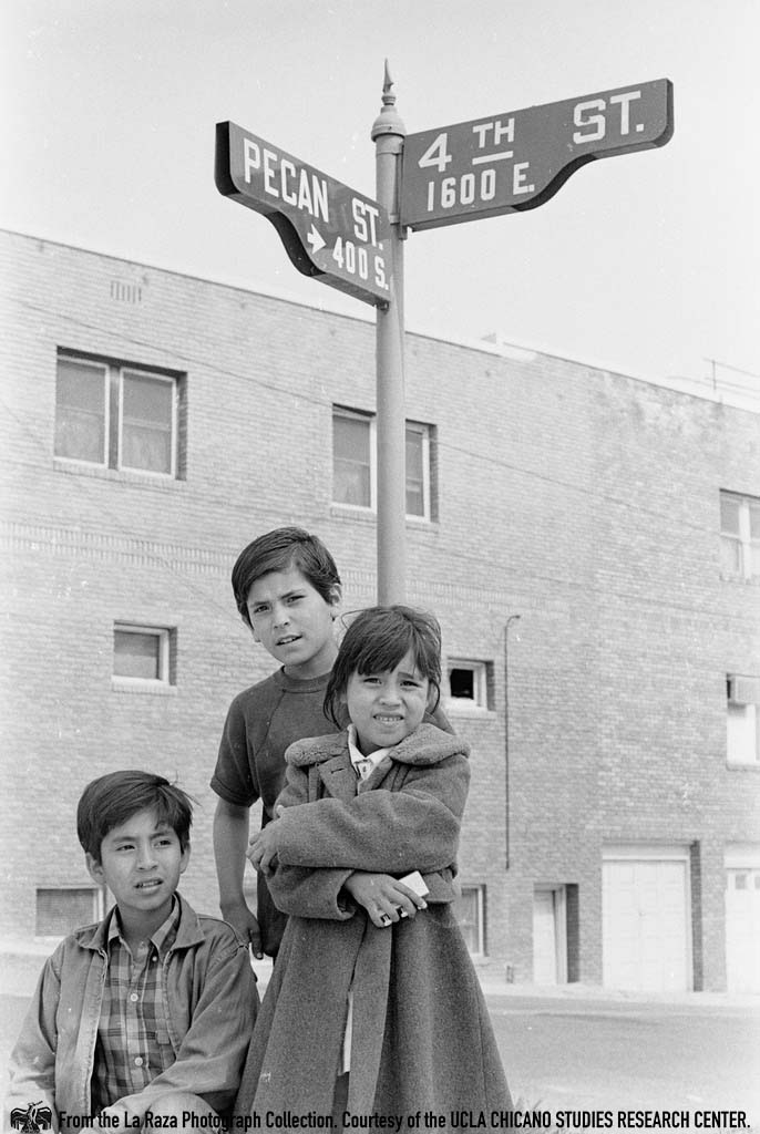 CSRC_LaRaza_B12F16C2_STAFF__002 Children petition for a traffic light at the corner of Fourth Street and Pecan Street in Los Angeles | La Raza photograph collection. Courtesy of UCLA Chicano Studies Research Center