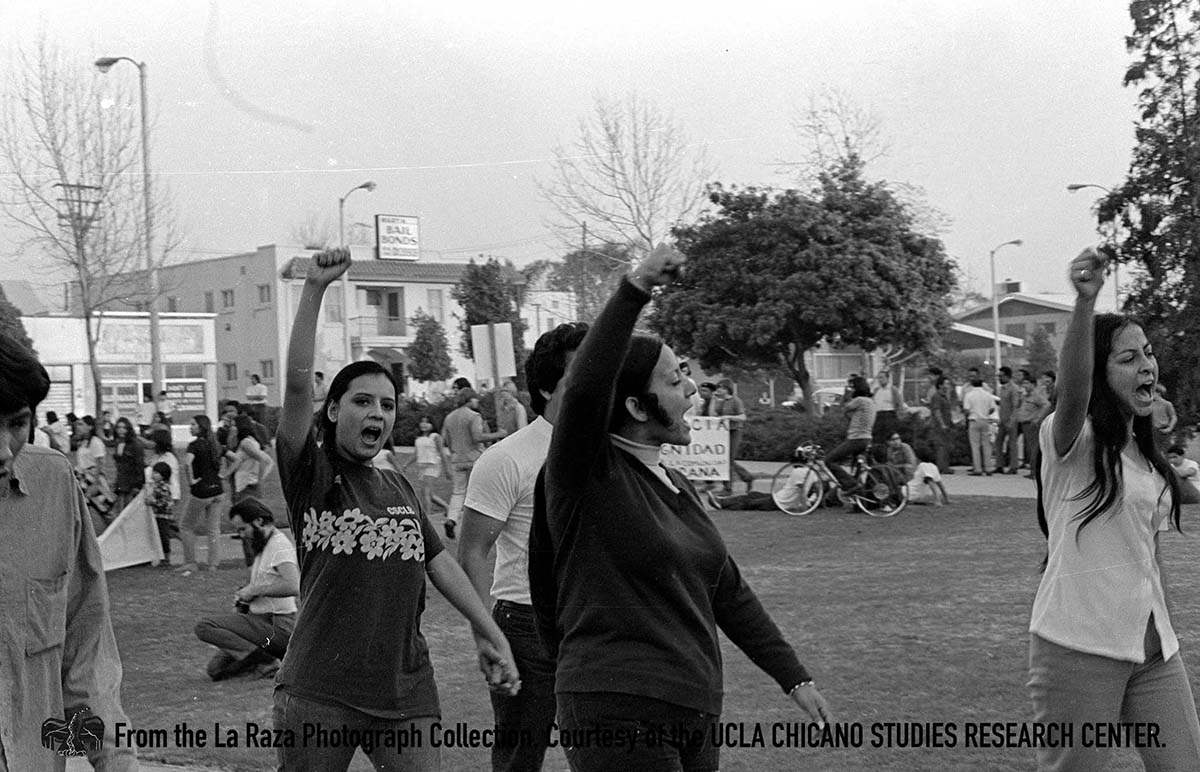 CSRC_LaRaza_B12F26S1_N030 Protesters at a demonstration | La Raza photograph collection. Courtesy of UCLA Chicano Studies Research Center