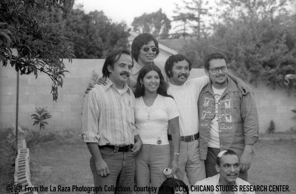 CSRC_LaRaza_B13F2S4_N012 A group of people, including Raul Ruiz, pose for a photograph for Rudy Salas' wedding | Pedro Arias, La Raza photograph collection. Courtesy of UCLA Chicano Studies Research Center