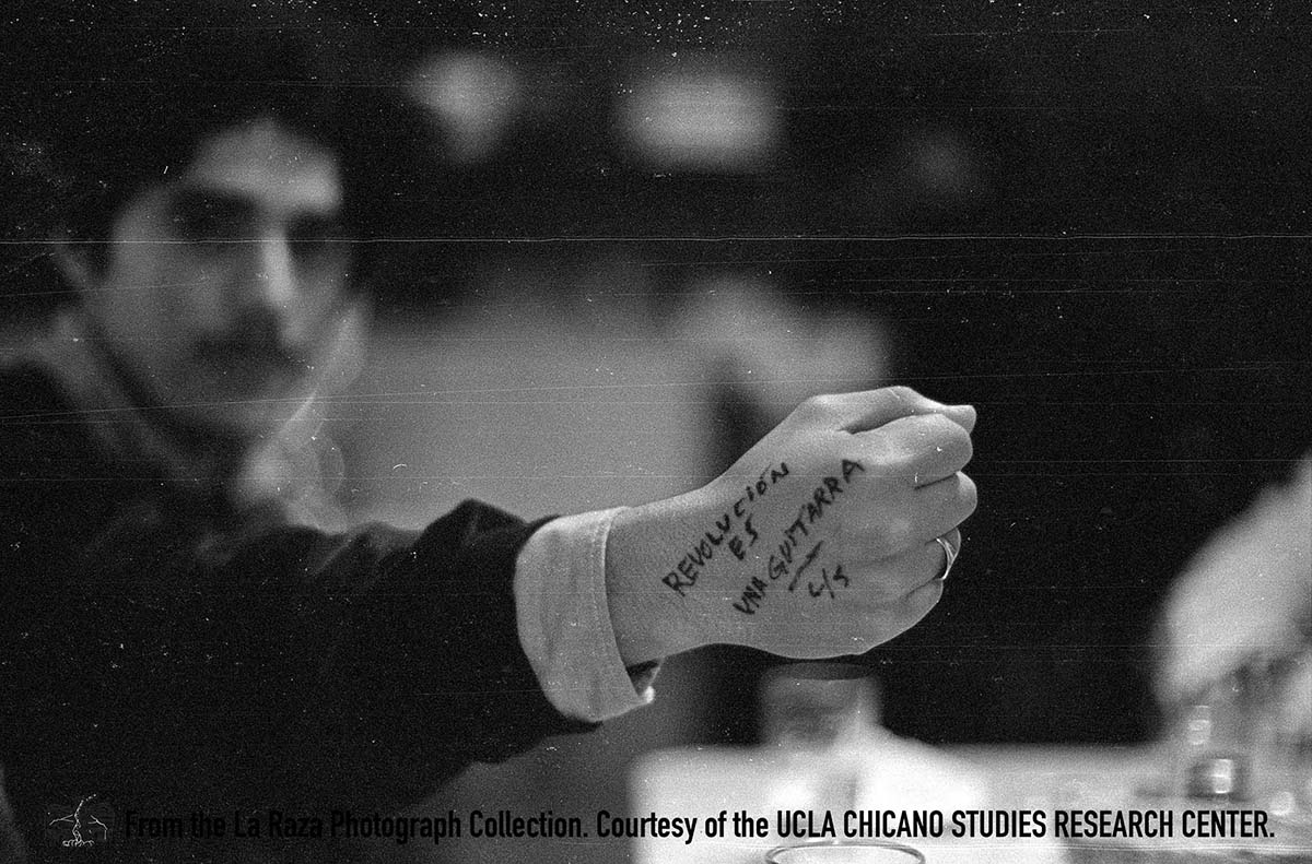 CSRC_LaRaza_B14F3S1_N032 A person with writing on their fist | La Raza photograph collection. Courtesy of UCLA Chicano Studies Research Center