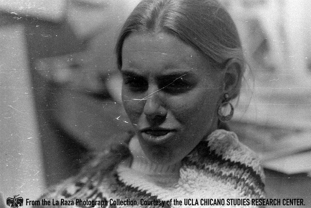 CSRC_LaRaza_B14F3S1_N040 Devra Weber inside the Chicano Student Movement newspaper office | La Raza photograph collection. Courtesy of UCLA Chicano Studies Research Center