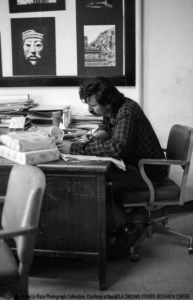 CSRC_LaRaza_B14F5S1_N014 A man, possibly Gilbert Cano, at La Raza office in City Terrace. | La Raza photograph collection. Courtesy of UCLA Chicano Studies Research Center