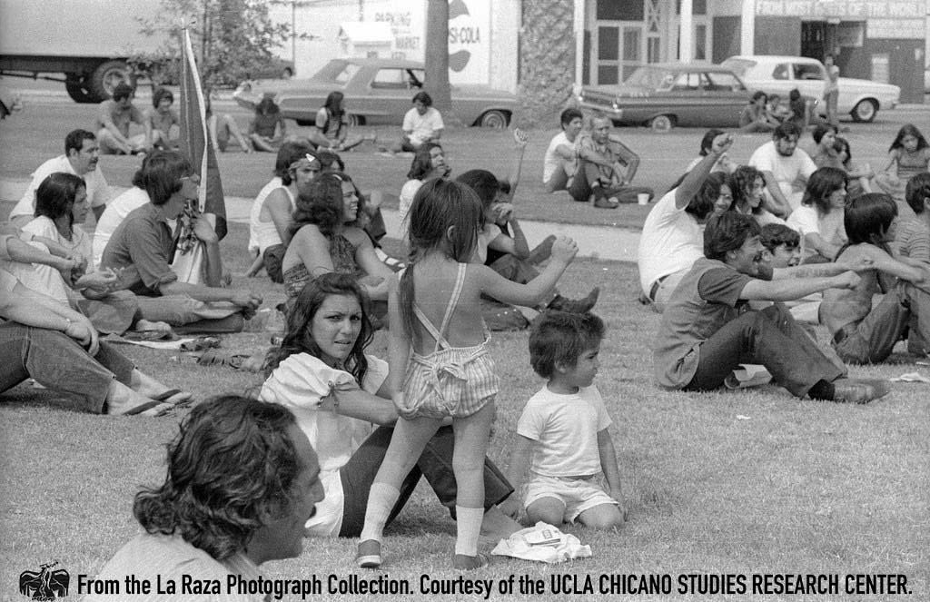 CSRC_LaRaza_B14F6S1_N017 Crowd of people listening during the Chicano Moratorium anniversary | Patricia Borjon Lopez, La Raza photograph collection. Courtesy of UCLA Chicano Studies Research Center