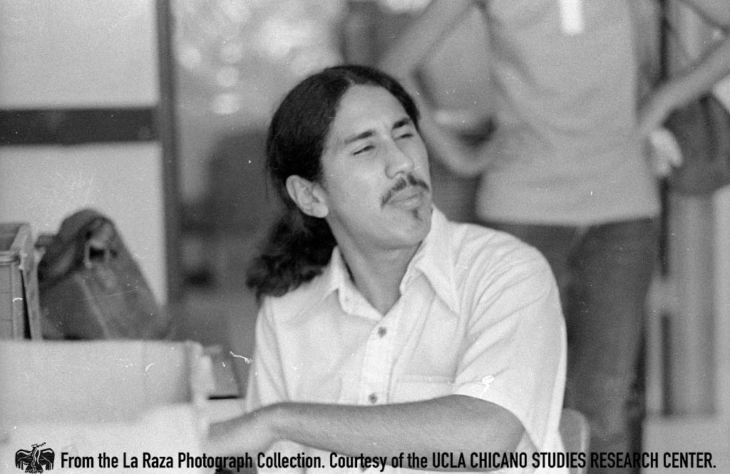 CSRC_LaRaza_B14F6S1_N030 Gilbert Lopez works inside the La Raza magazine office | Patricia Borjon, La Raza photograph collection. Courtesy of UCLA Chicano Studies Research Center
