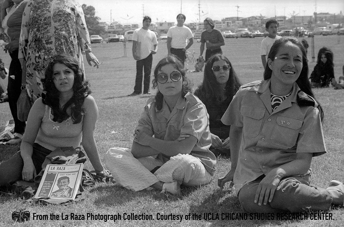 CSRC_LaRaza_B14F7S1_N001 People, including Brown Berets members, sit on lawn | Daniel Zapata, La Raza photograph collection. Courtesy of UCLA Chicano Studies Research Center