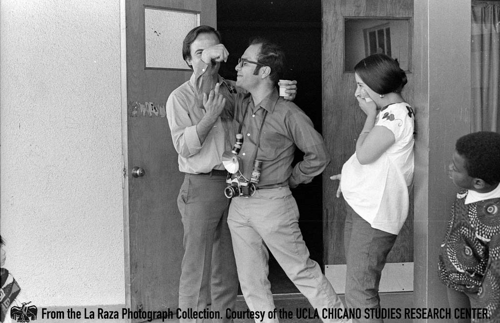 CSRC_LaRaza_B14F8S1_N018 Raul Ruiz, Manuel Barrera, Jr., Patricia Borjon of La Raza | Luis Garza, La Raza photograph collection. Courtesy of UCLA Chicano Studies Research Center
