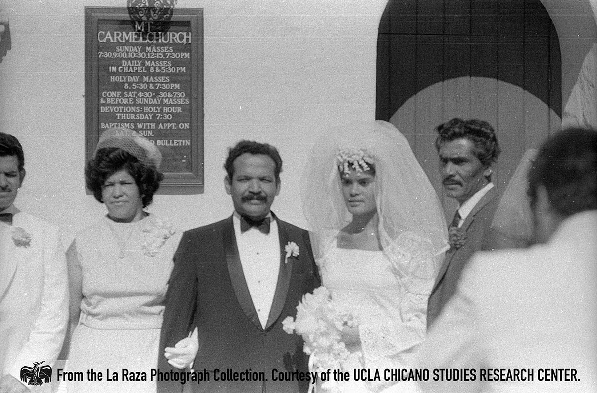 CSRC_LaRaza_B14F9S1_N002 Bride and groom pose for Eliezer Risco's wedding day | La Raza photograph collection. Courtesy of UCLA Chicano Studies Research Center