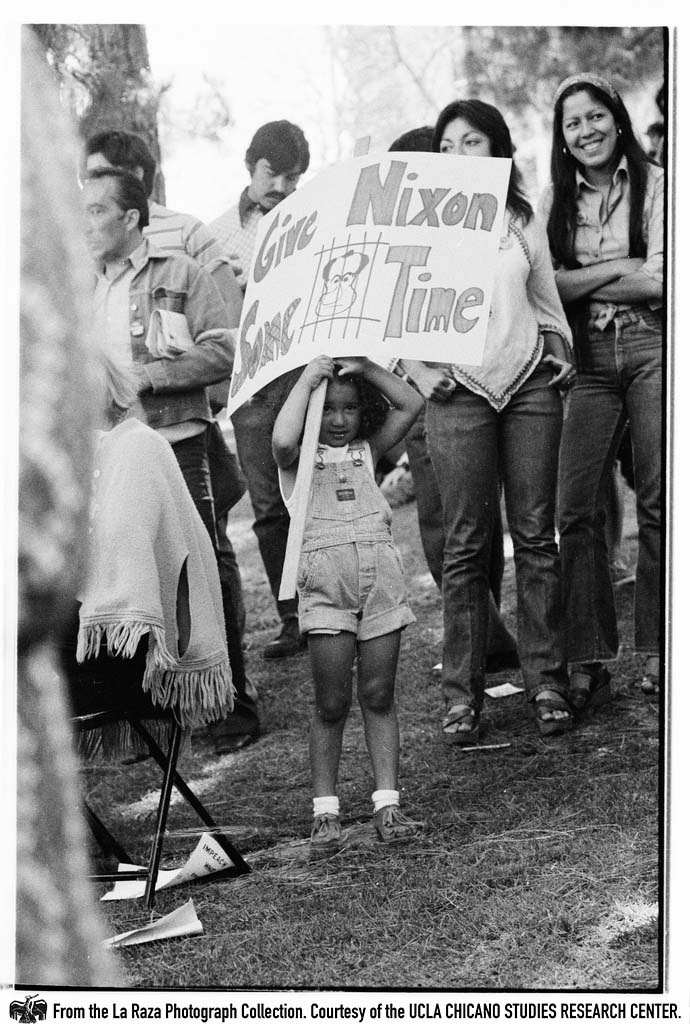 "CSRC_LaRaza_B15F14C1_Staff_016 Girl holds ""Give Nixon Some Time"" sign at  ""Dump Nixon"" march from Echo Park to MacArthur Park 