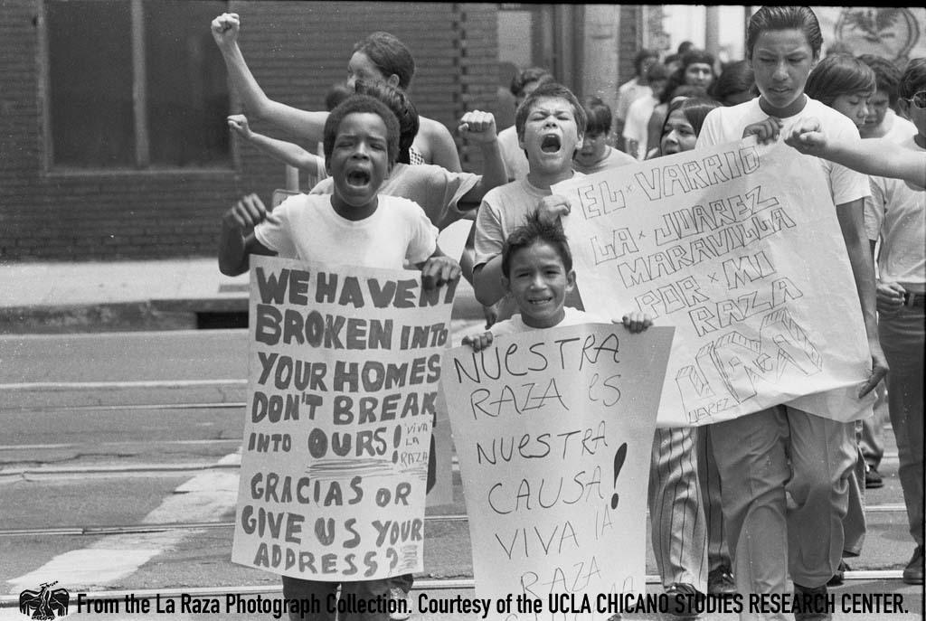 CSRC_LaRaza_B15F2C1_DZ_016 Protesters in la Marcha por los Tres in front of L.A. City Hall | Daniel Zapata, La Raza photograph collection. Courtesy of UCLA Chicano Studies Research Center