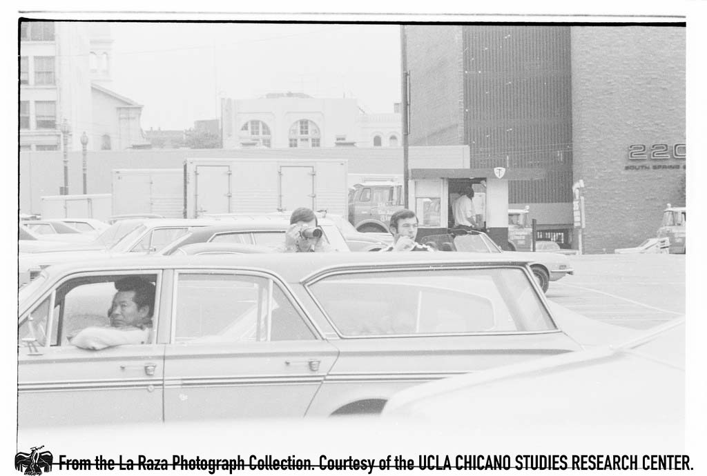 CSRC_LaRaza_B15F5C1_Staff_003 Man photographs protesters against Rodino Bill   Raul Ruiz, La Raza photograph collection. Courtesy of UCLA Chicano Studies Research Center
