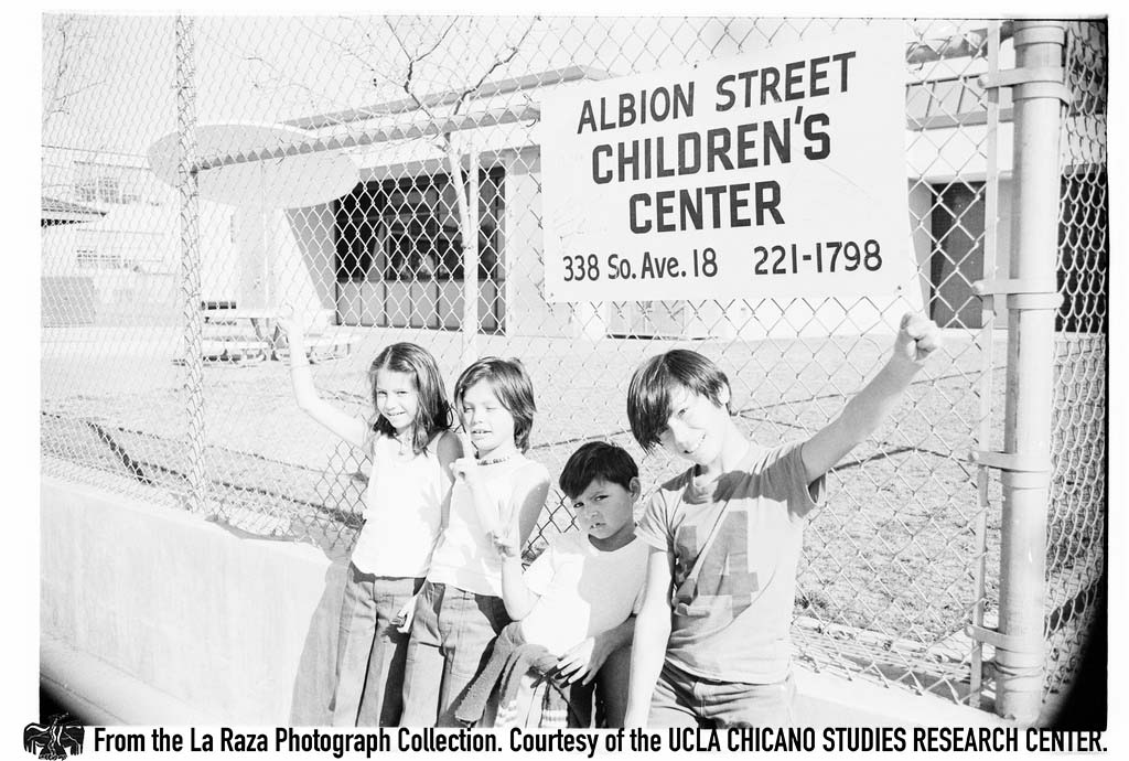 CSRC_LaRaza_B16F2C1_Staff_008 Children in front of the Albion Street Early Education Center | Sixto Tarango, La Raza photograph collection. Courtesy of UCLA Chicano Studies Research Center