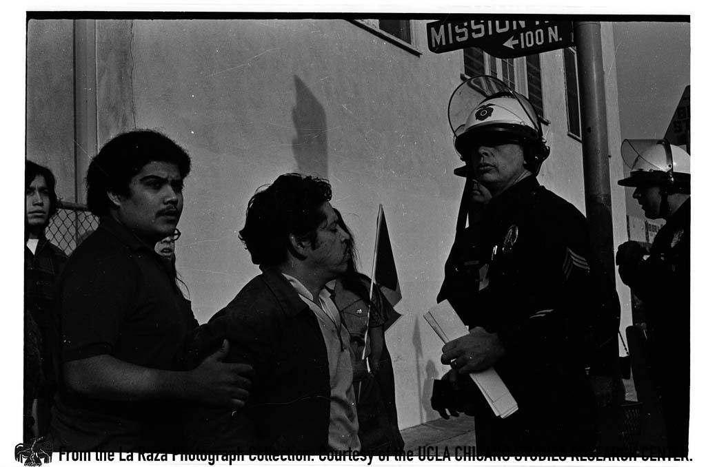 CSRC_LaRaza_B16F6C3_Staff_014 LAPD officers confront protesters at Police Brutality March | La Raza photograph collection. Courtesy of UCLA Chicano Studies Research Center