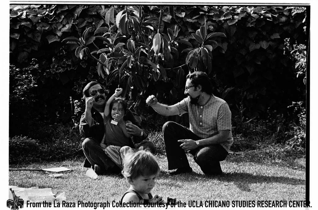 CSRC_LaRaza_B16F6C9_Staff_025 Two men and children | La Raza photograph collection. Courtesy of UCLA Chicano Studies Research Center