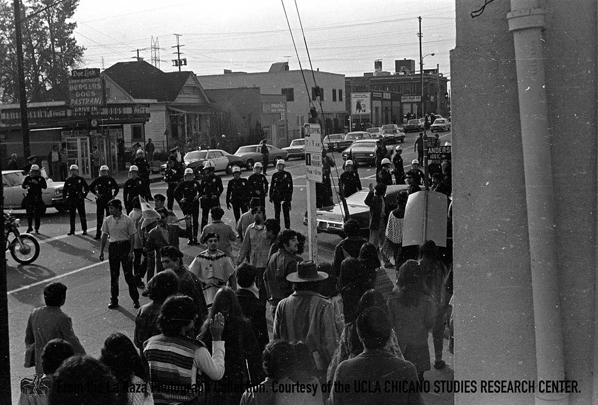 CSRC_LaRaza_B16F6S4_N001 LAPD officers confront protesters at police brutality march | La Raza photograph collection. Courtesy of UCLA Chicano Studies Research Center