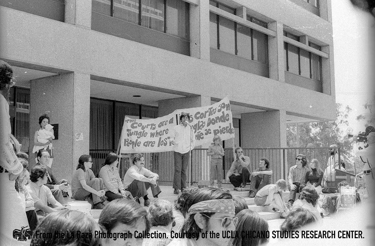 CSRC_LaRaza_B16F7S1_N081 Man speaks at a demonstration at USC Gould School of Law | La Raza photograph collection. Courtesy of UCLA Chicano Studies Research Center