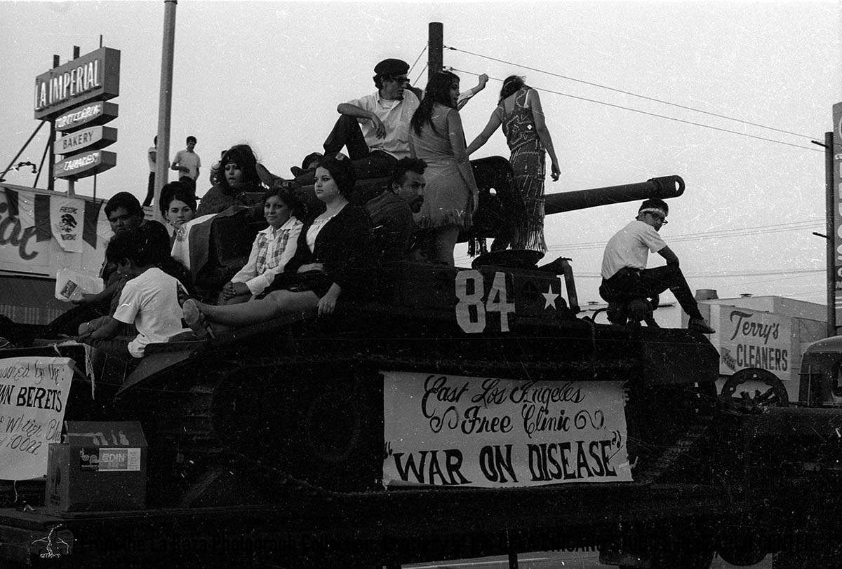 CSRC_LaRaza_B17F19S1_N006 People atop a tank during Mexican Independence Day | La Raza photograph collection. Courtesy of UCLA Chicano Studies Research Center