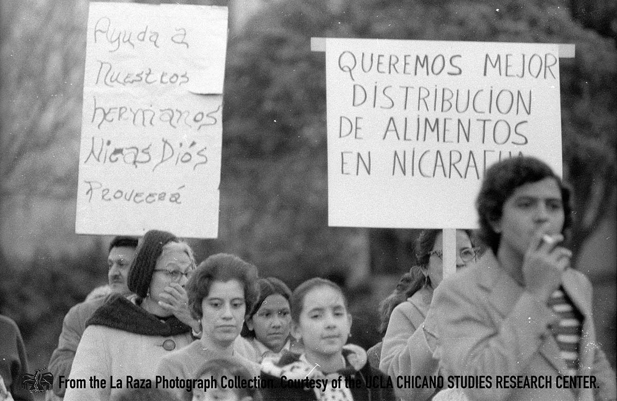 CSRC_LaRaza_B17F24S3_N011 People carry signs at Ricardo Chavez Ortiz support march | Raul Ruiz, La Raza photograph collection. Courtesy of UCLA Chicano Studies Research Center
