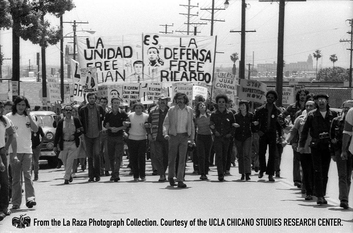 CSRC_LaRaza_B17F24S3_N023 People carry signs at Ricardo Chavez Ortiz support march | Raul Ruiz, La Raza photograph collection. Courtesy of UCLA Chicano Studies Research Center