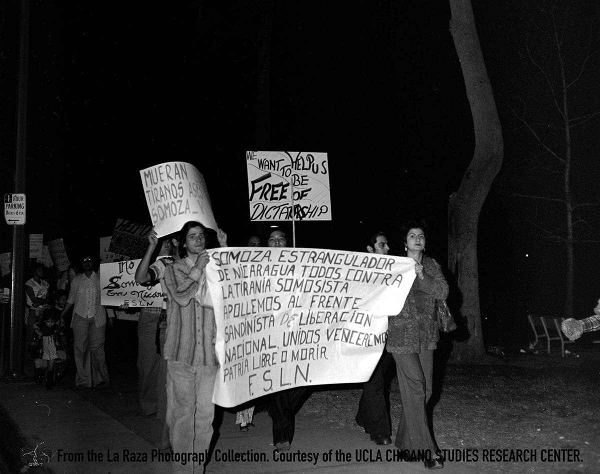 CSRC_LaRaza_B17F4S1_N021 People in an anti-Somoza protest in Los Angeles | Manuel Barrera, Jr., La Raza photograph collection. Courtesy of UCLA Chicano Studies Research Center
