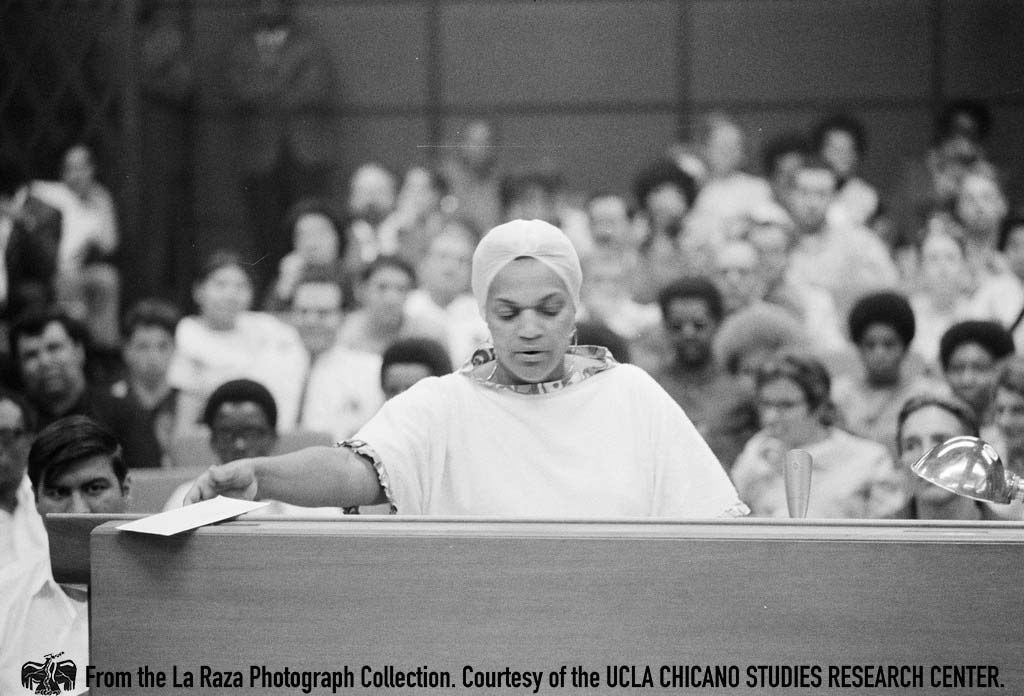 CSRC_LaRaza_B1F11C1_Staff_006 Woman speaks at the LAUSD Board of Education meeting on the transfer of Sal Castro | La Raza photograph collection. Courtesy of UCLA Chicano Studies Research Center