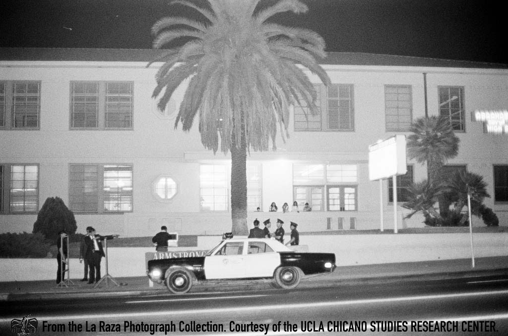 CSRC_LaRaza_B1F11C3_RR_012 LAPD officers at Lincoln High School | Raul Ruiz, La Raza photograph collection. Courtesy of UCLA Chicano Studies Research Center