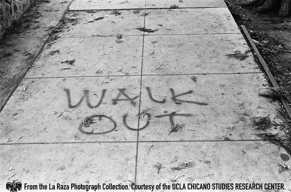 "CSRC_LaRaza_B1F3C4_DW_025 ""Walkout"" sprayed on the sidewalk during the Roosevelt High School walkout 