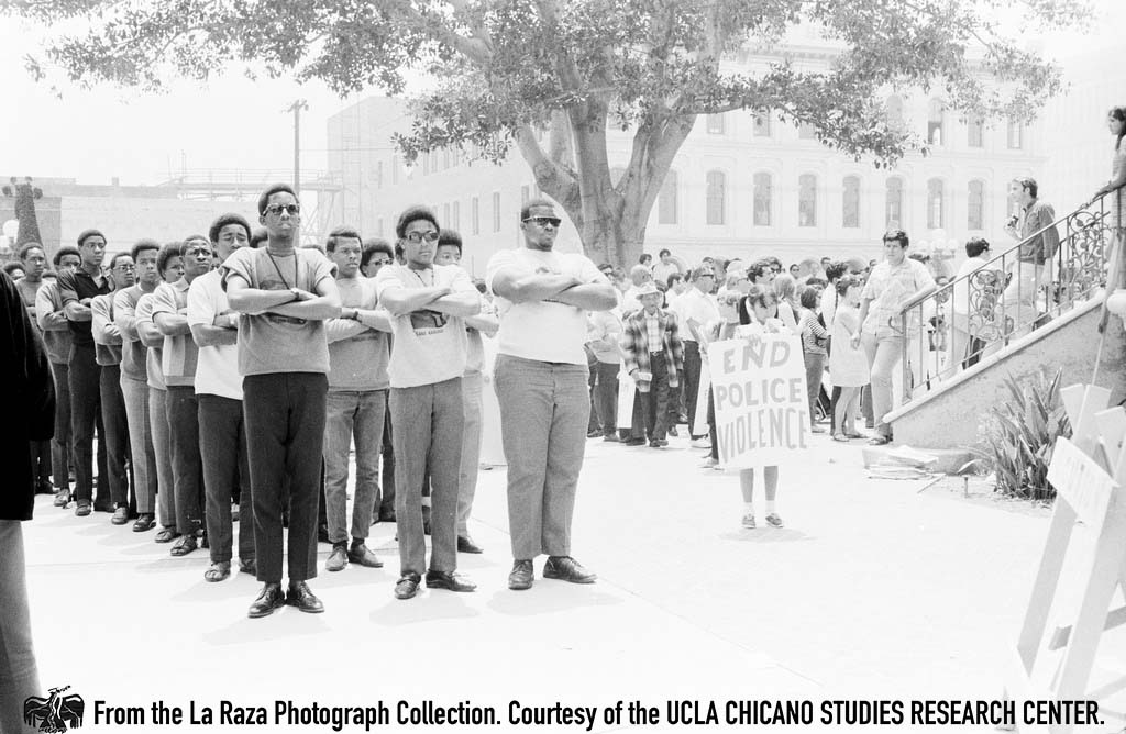 "CSRC_LaRaza_B1F4C8_Staff_004 The US Organization, founded by Maulana (Ron) Karenga, marches in support of the LA 13. ""The black community assisted us throughout our struggles,"" comments Joe Razo 