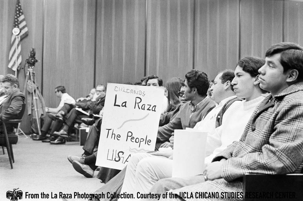 CSRC_LaRaza_B1F7C1_DW_005 Students demand the removal of John Hogan, a teacher at Roosevelt High School who made racist remarks toward students, at an LAUSD Board of Education meeting | Devra Weber, La Raza photograph collection. Courtesy of UCLA CSRC
