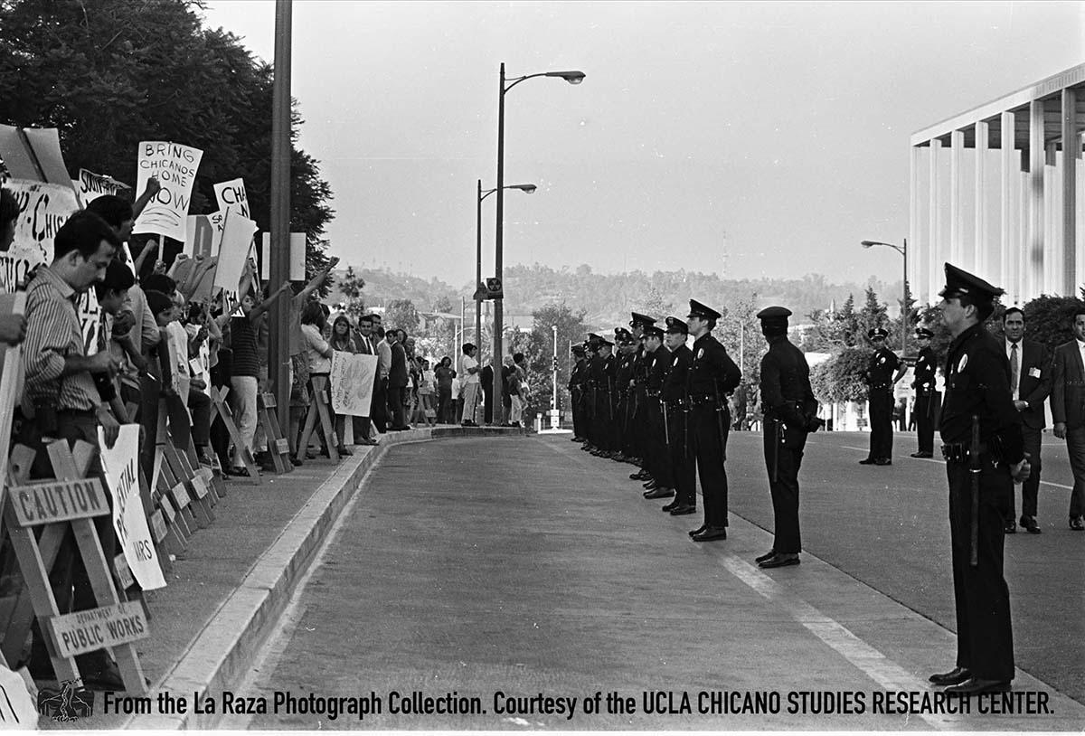 CSRC_LaRaza_B4F11C2_Staff_008 Anti-war protest during President Nixon's visit to Los Angeles | La Raza photograph collection. Courtesy of UCLA Chicano Studies Research Center