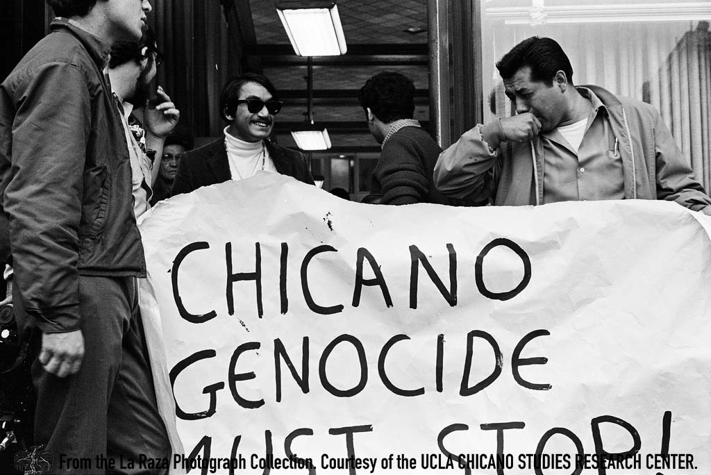 CSRC_LaRaza_B4F2C2_Staff_010 Rosalio Muñoz exits the Armed Forces Examining and Entrance Station  | La Raza photograph collection. Courtesy of UCLA Chicano Studies Research Center
