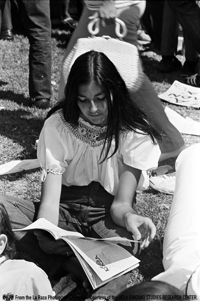 CSRC_LaRaza_B4F4C2_JR-RR_014 Young woman at Laguna Park during the National Chicano Moratorium | La Raza photograph collection. Courtesy of UCLA Chicano Studies Research Center
