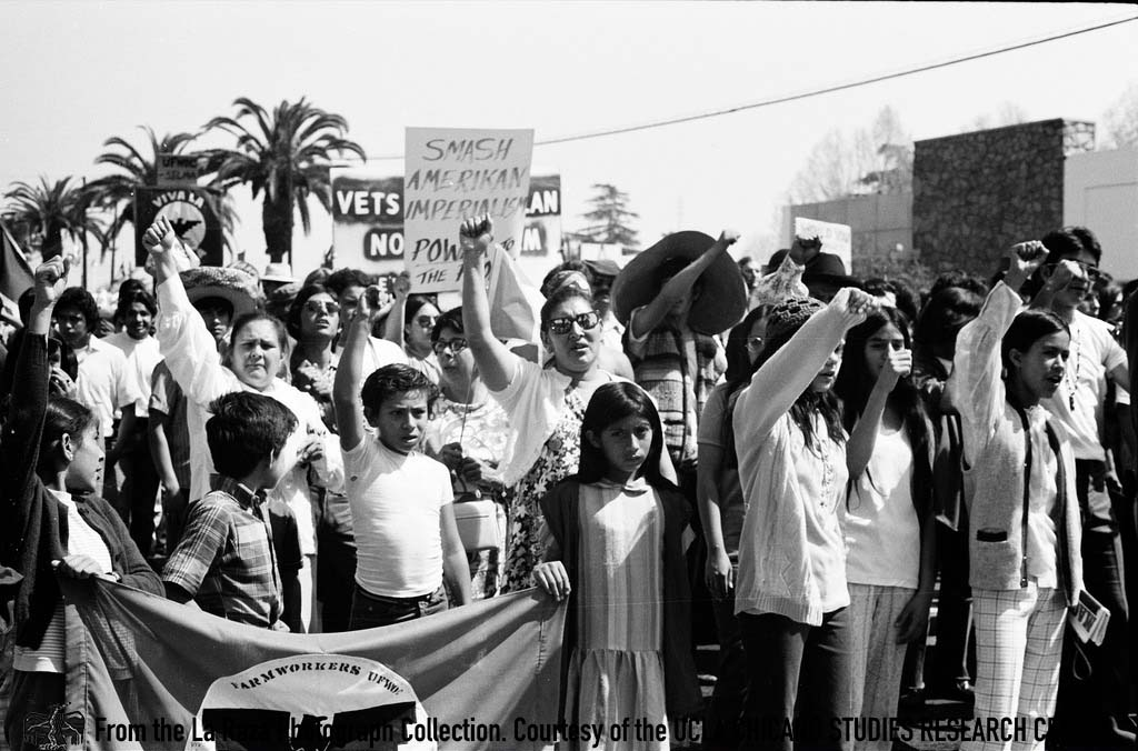 CSRC_LaRaza_B5F3C10_PB_006 Protester at the Fresno Moratorium | Patricia Borjon Lopez, La Raza photograph collection. Courtesy of UCLA Chicano Studies Research Center