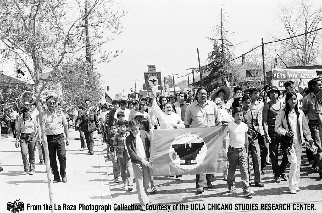 CSRC_LaRaza_B5F3C1_DZ_008 People march at Fresno Moratorium | Daniel Zapata, La Raza photograph collection. Courtesy of UCLA Chicano Studies Research Center